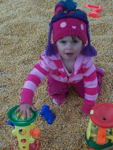 Playing in the Corn Box at the Farm